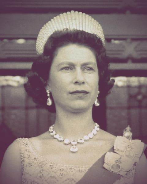 Queen Elizabeth II of Great Britain wearing Queen Alexandra's kokoshnik tiara. She's also wearing enormous diamond earrings and necklace.