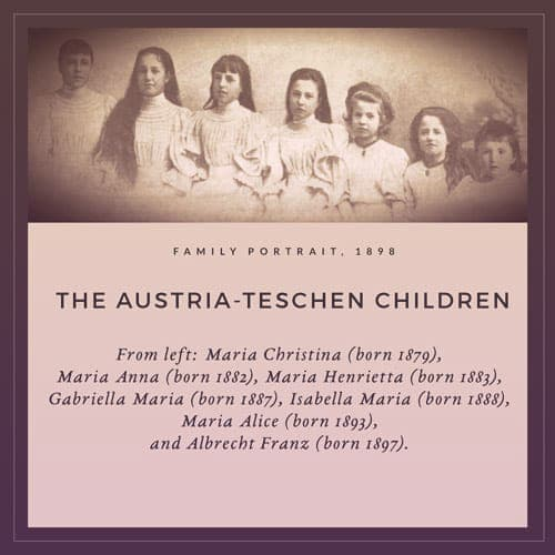 The Austria-Teschen children in 1898, from left to right: Maria Christina, Maria Anna, Maria Henrietta, Gabriella Maria, Isabella Maria, Maria Alice, and Albrecht Franz. The girls are wearing similar white dresses, high-necked with lots of pleats in the bodices. Albrecht is wearing a white blouse. Maria Anna is the only girl with her hair hanging forward over her shoulder.  | From Archduchess Maria Anna of Austria's Tiara on GirlInTheTiara.com.