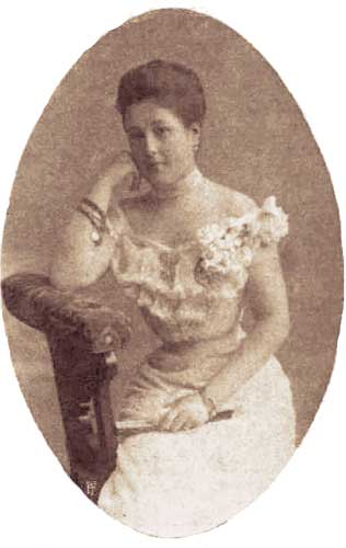 Archduchess Maria Anna of Austria. She's seated sideways on a chair, with her arm raised onto the chair back. She's holding a fan and wearing a ball gown.  | From Archduchess Maria Anna of Austria's Tiara on GirlInTheTiara.com.