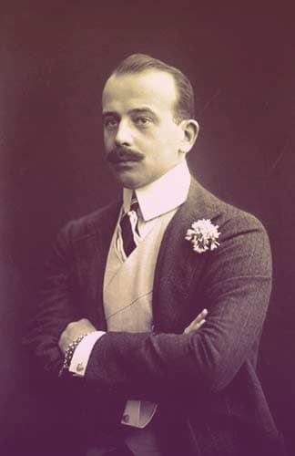 Prince Max of Baden, a dapper dark-haired man with a moustache wearing a snazzy suit with a flower in his buttonhole. | From Archduchess Maria Anna of Austria's Tiara on GirlInTheTiara.com.
