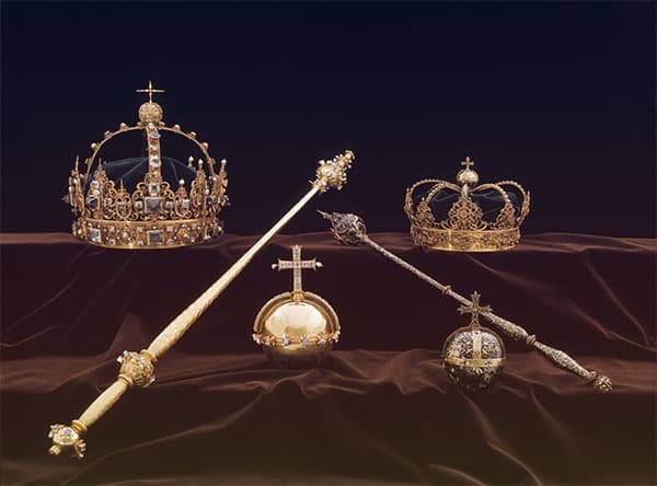King Karl IX and Queen Kristina of Sweden's burial regalia - two golden crowns, two scepters, and two orbs | from Tiaras in the News 2019