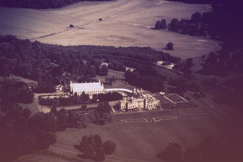 An aerial photo of Welbeck Abbey, the seat of the Dukes of Portland. The shot shows two main building complexes, the residential Abbey and the museum on the estate | from Tiaras in the News 2019