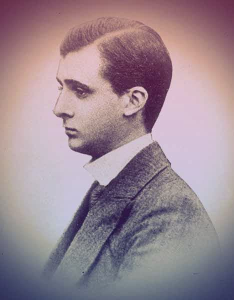 John Manners as a young man pictured in profile. He's wearing a suit jacket, tie, and white-collard shirt. His hair is short and neat, with a part over his left eyebrow. He looks melancholy. | The Secret Rooms by Catherine Bailey book review