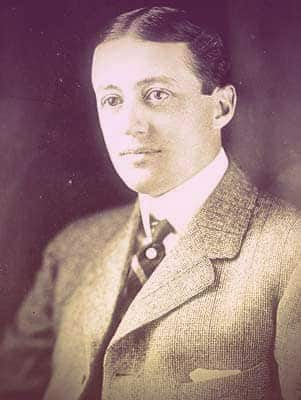 A photo of Peter as a young man. His hair is short and slicked-back, parted straight down the middle. he's wearing a nice tweed suit. His large eyes and pale brows make him look a little moon-faced. | From The Yusupov Black Pearl Necklace on GirlInTheTiara.com.