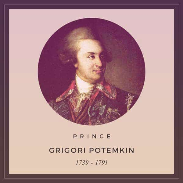 A portrait of Prince Grigori Potemkin (1739-1791). He has fluffy powdered hair, curled over his ears in the style of the late 18th century. He's wearing an ornate blue jacket with gold braid, military decorations, satin bows, and a large red collar. | From The Yusupov Black Pearl Necklace on GirlInTheTiara.com.