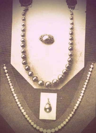 An image of four Yusupov jewels arranged for display on cardboard mounts. There is a black pearl necklace with exactly 30 pearls. | From The Yusupov Black Pearl Necklace on GirlInTheTiara.com.