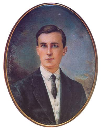 Prince Felix Yusupov wearing a dark suit, white vest and shirt, with a dark tie.
