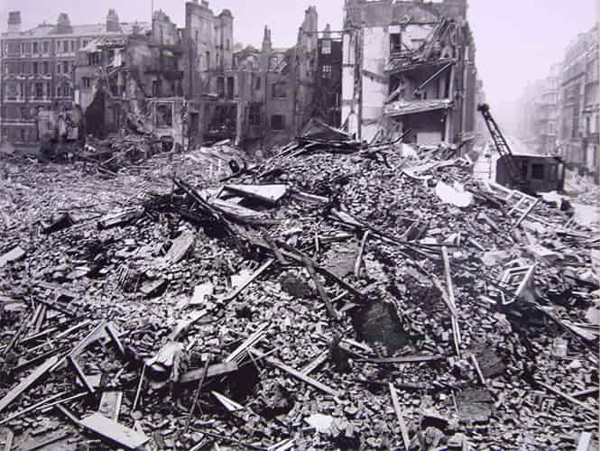 A huge pile of rubble  beside the shells of bombed out buildings on London's Hallam Street.