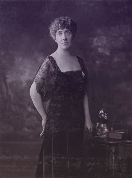 Princess Marie Louise wearing a black lace dress and diamond brooch.