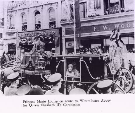 Princess Marie Louise in a carriage, looking out at the crowd standing along the street.