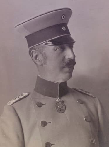 Prince Aribert of Anhalt wearing a military uniform with a medal hanging beneath the center of his collar.