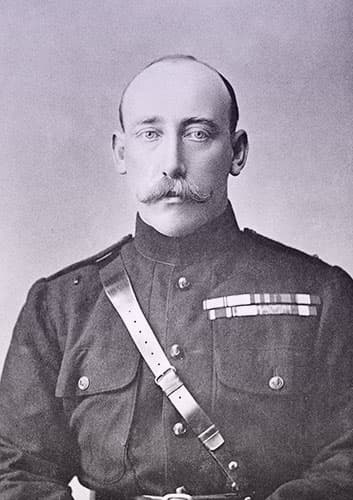 Prince Christian Victor of Schleswig-Holstein wearing a military uniform. He has a receding hairline and a bushy mustache curling up at the ends.