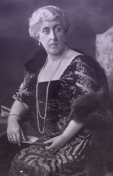 Princess Helena Victoria wearing a glittery black evening gown with two long strands of pearls and pearl earrings.