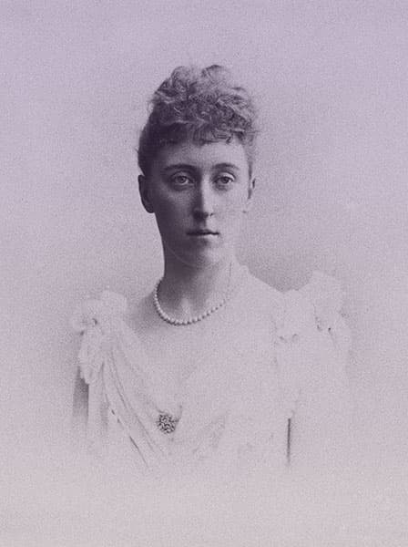 Princess Helena Victoria of Schleswig-Holstein in a white evening gown with a pearl necklace.