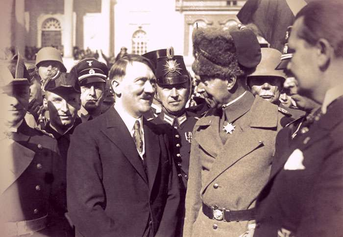 Adolph Hitler staring adoringly at Crown Prince Wilhelm of Prussia.