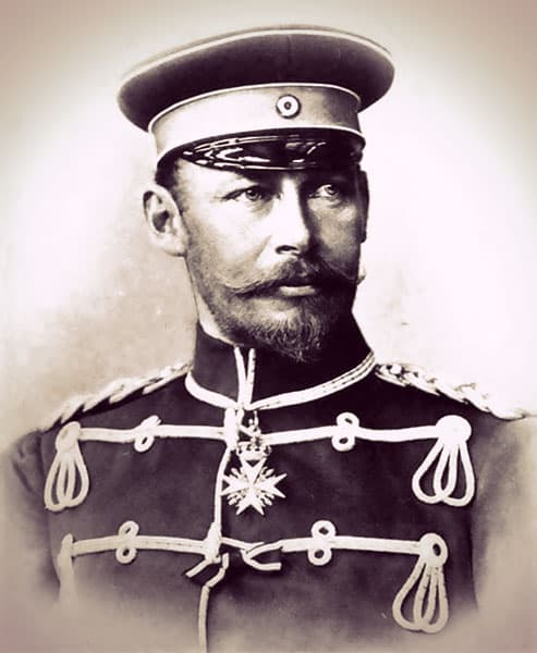 Friedrich Franz III wearing an elaborate military tunic with gold braid at the shoulders. He has an elegant curled mustache and a small pointed beard.