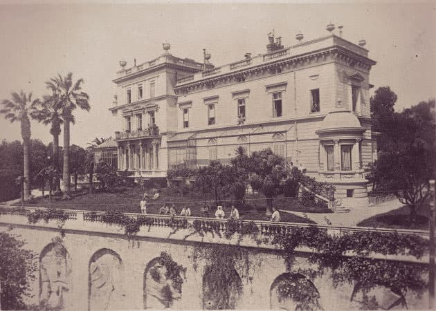 A three-story Italianate mansion with a garden sloping down to a 90-foot wall.