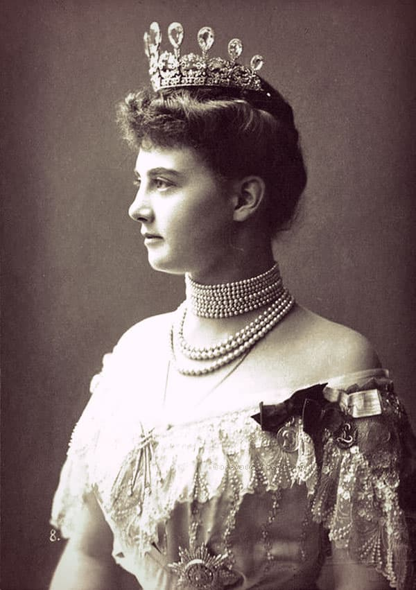 Alexandra of Mecklenburg-Schwerin in a lacy off-the-shoulder evening gown. She's wearing the aquamarine and diamond tiara as well as a multi-strand pearl choker and three more pearl necklaces.