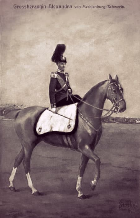 Alexandra of Mecklenburg-Schwerin in military uniform (including helmet), riding sidesaddle on a horse.