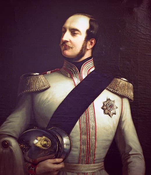 George wearing an ivory military tunic embroidered with gold and red. He holds a silver helmet with a white plume.