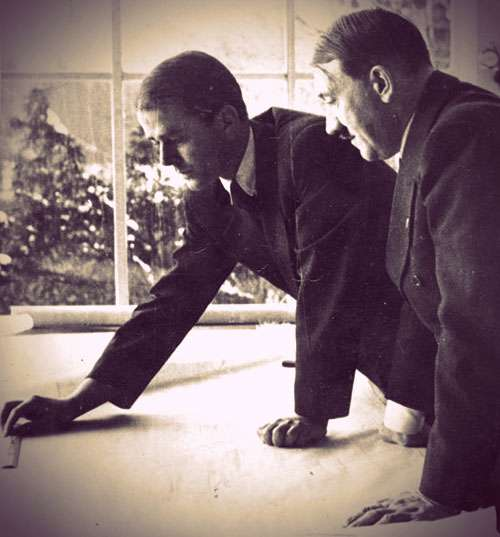 Speer and Hitler looking at architectural plans together.