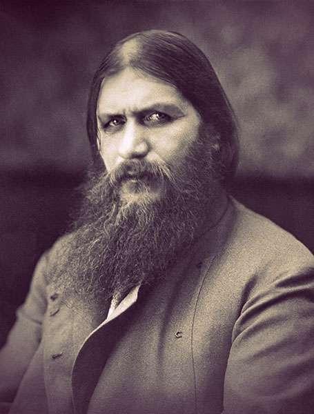 Rasputin wearing a plain gray jacket. He had long hair and a frizzy beard.