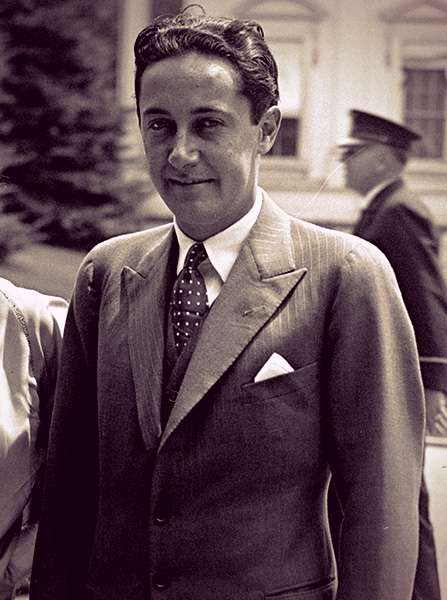 Irving Thalberg wearing a three-piece suit and polka-dot tie.