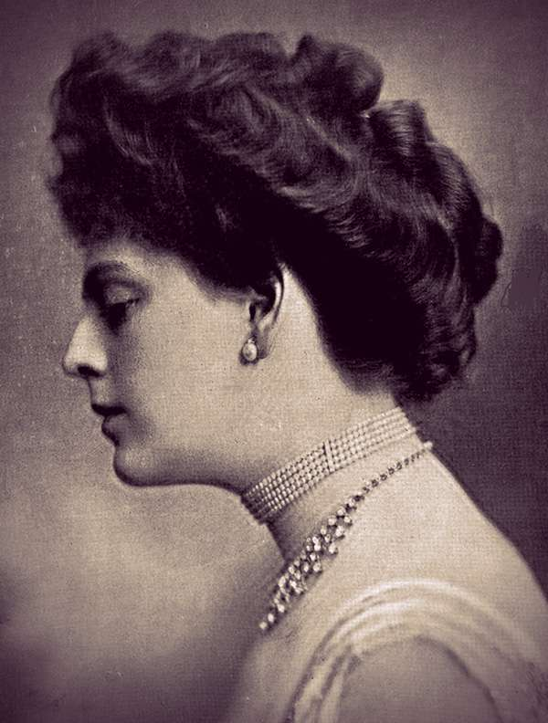 Ethel Barrymore in profile, with her hair in an updo and wearing a pearl choker and diamond or rhinestone necklace.