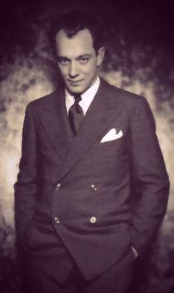 Charles MacArthur in a dark, double-breased suit.