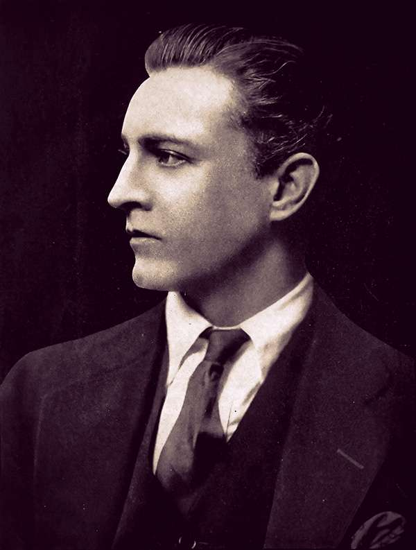 Profile photo of John Barrymore -he has a sharp, handsome profile and slicked-back brown hair.
