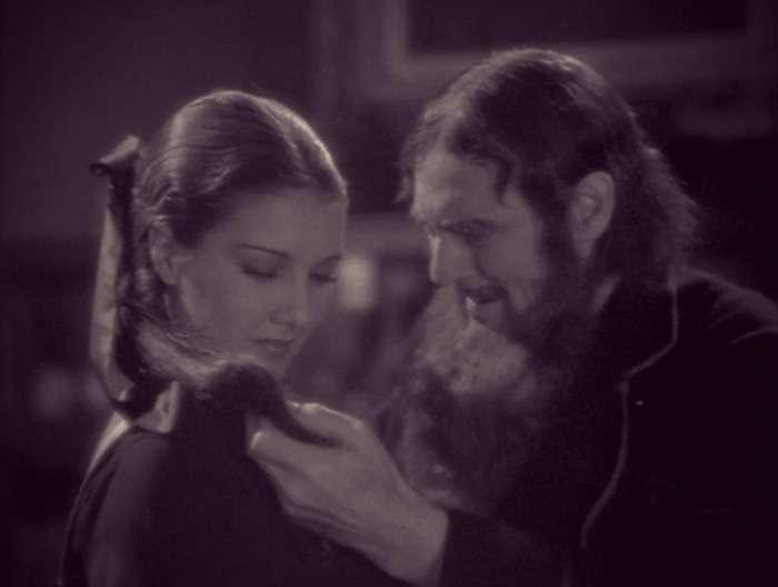 Screenshot of Rasputin toying with Grand Duchess Maria's hair.