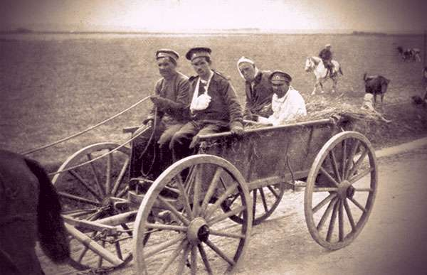 Wounded Russian soldiers in a horse-drawn cart, making their way to a field hospital.