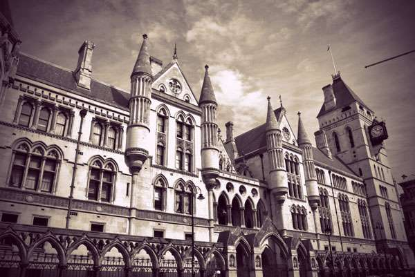 The gothic revival exterior of the Royal courts of Justice building in London.